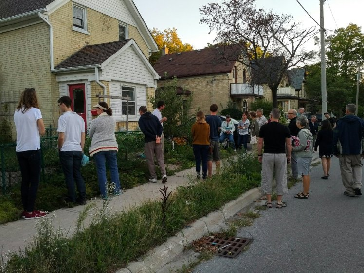 "A neighbourhood walking tour to see the ""before"" yards, a water problem area at Dekay & Shanley Streets, and example of a finished rain garden."