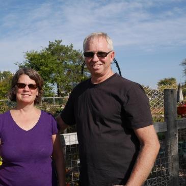 Steve and Kathy Hiller visit the Geulph Street Community Garden where Steve's Hiller family lived decades ago.