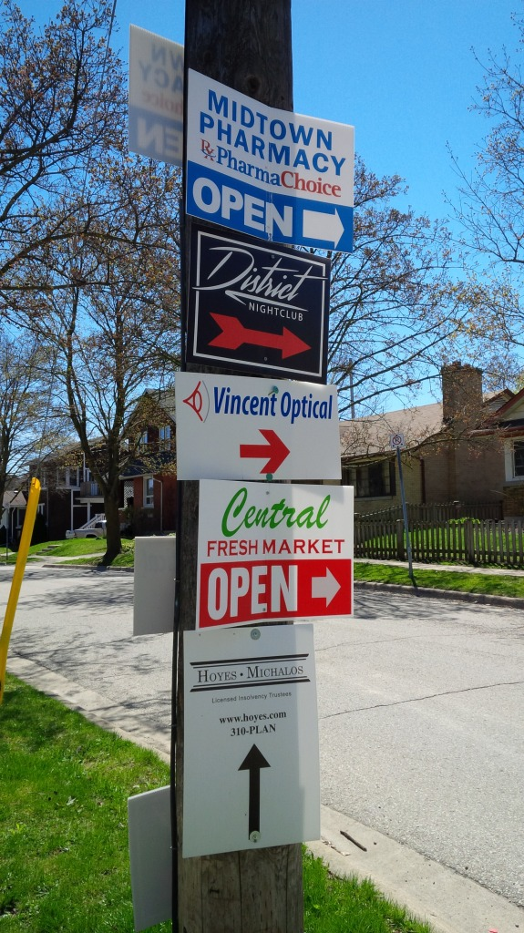 proliferation of signs in midtown kw
