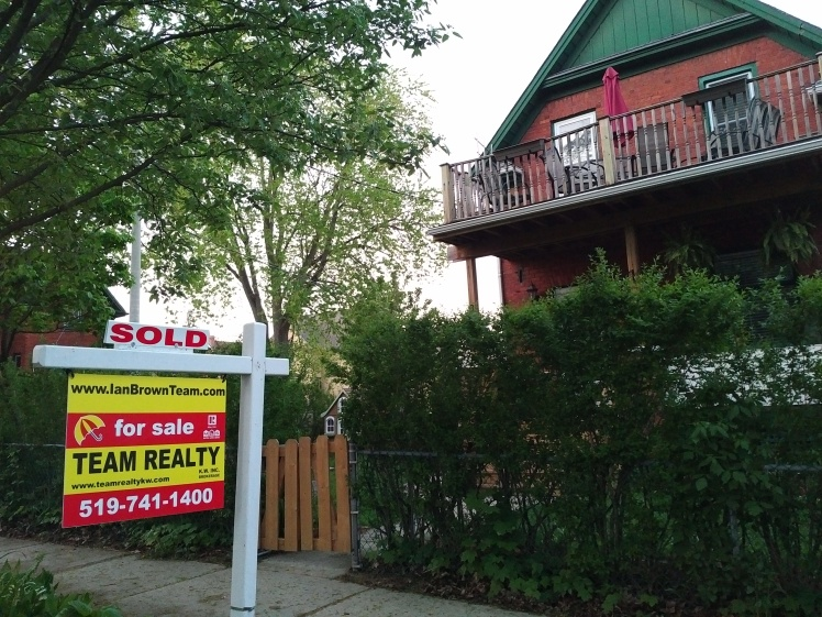 sold sign in midtown kw