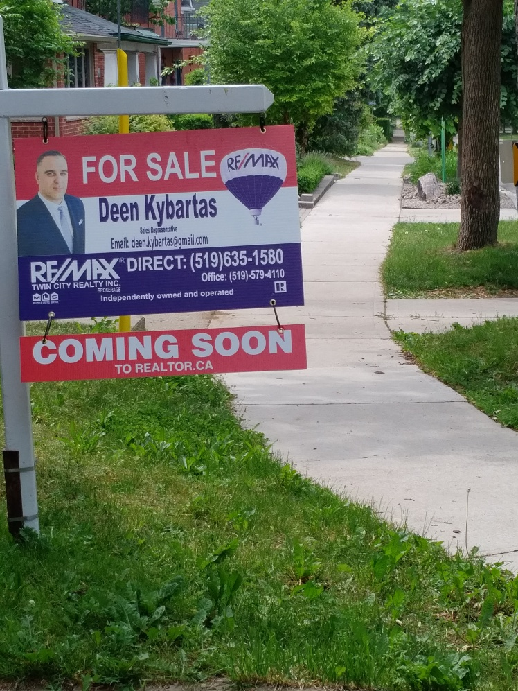 coming soon real estate sign in midtown kw