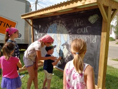 Neighbourhood kids create art for the back side of the chalkbaords