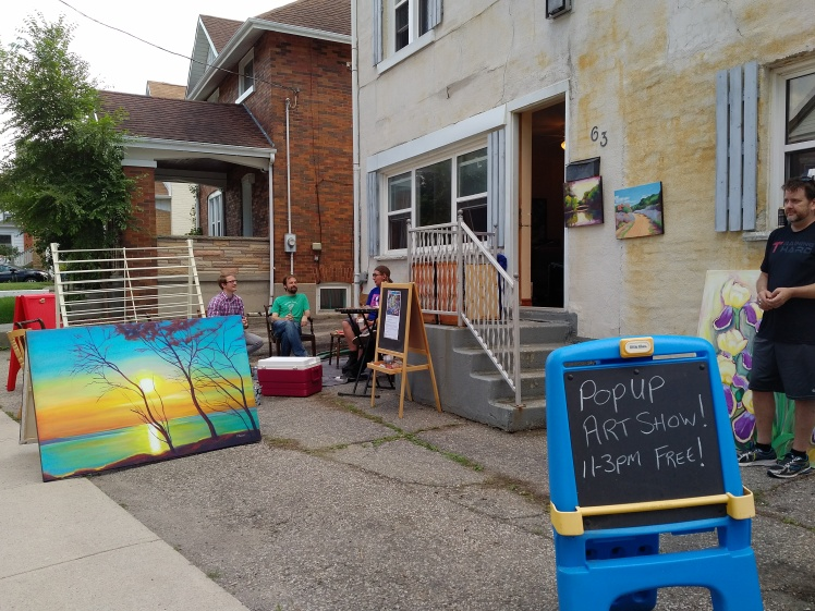 Front yard art show on DeKay Street