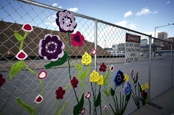 chainlink fence with crochet flowers