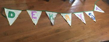 bunting flags spelling out Dekay St.