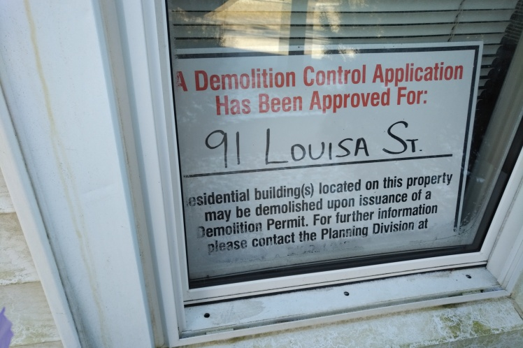 example of community information sign for a demolition request on a Louisa Street property