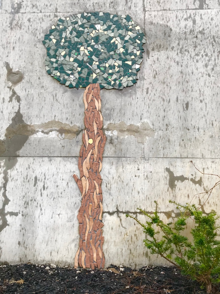 Mosaic tree art on concrete wall