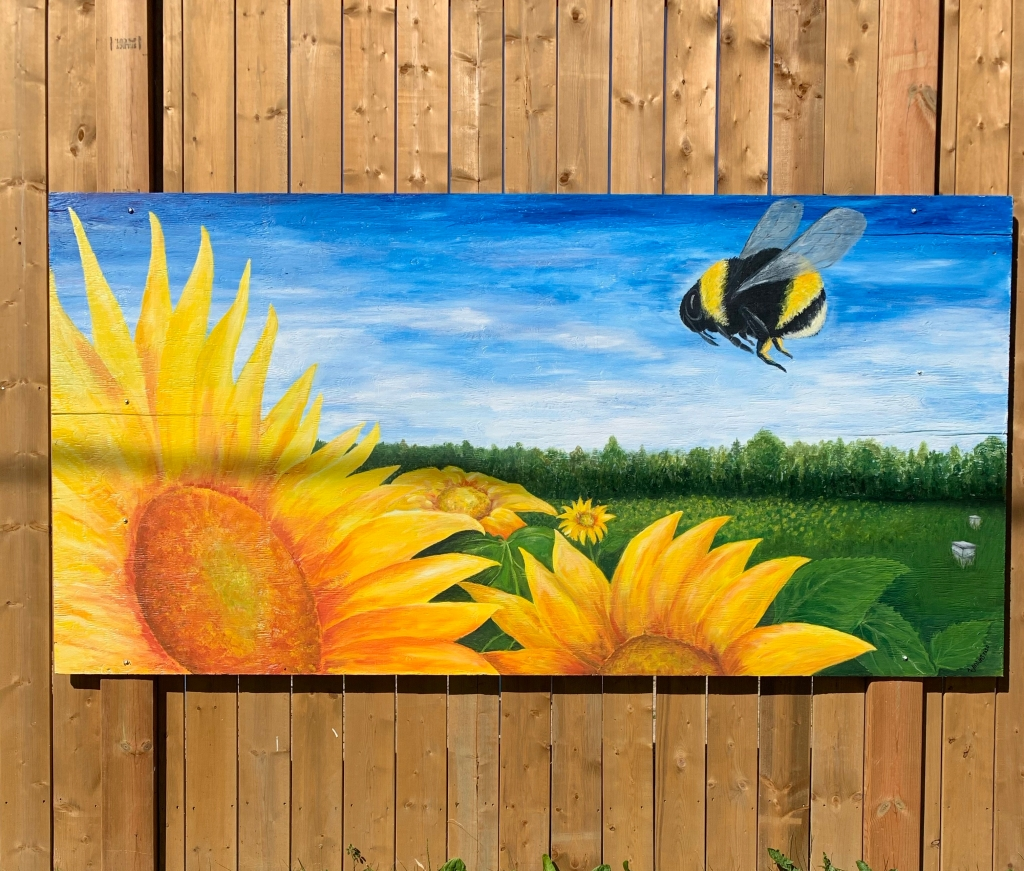painted mural of giant sunflowers and bees